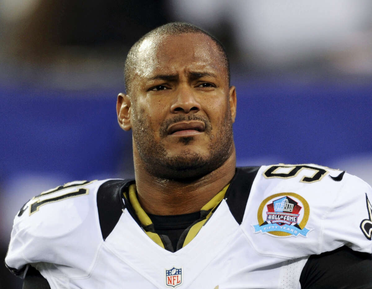 In this Dec. 9, 2012 photo, New Orleans Saints defensive end Will Smith appears before an NFL football game against the New York Giants in East Rutherford, N.J. The trial for Cardell Hayes charged with second-degree murder in the April 9, 2016 shooting death of Smith begins with jury selection Monday, Dec. 5, 2016.