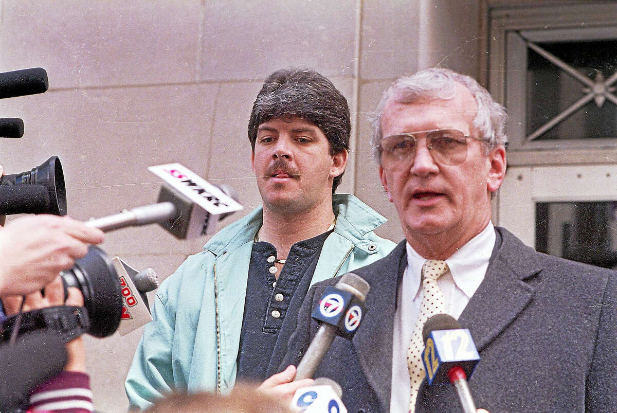 In this 1989 file photo, Ronald Peters, left, waits as his lawyer James Ruppert answers questions after Peters appeared before a federal magistrate in Cincinnati.