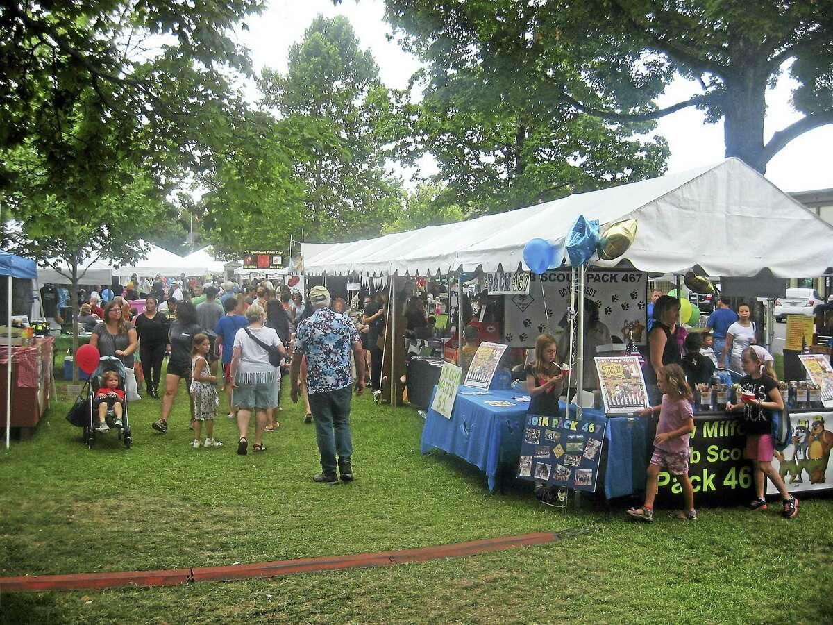 Photos by John Torsiello Residents stroll through the vendor area Saturday at the New Milford Village Fair Days.