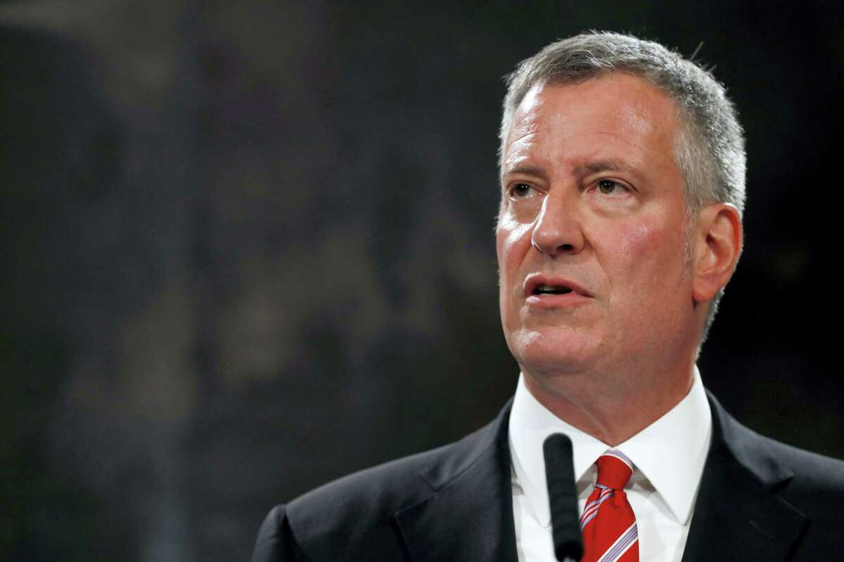 New York City Mayor Bill de Blasio speaks during a news conference, Tuesday, Aug. 2, 2016, in New York's City Hall. New York City Police Commissioner William Bratton is leaving the nation's largest police force, after a tenure in which he received credit for keeping crime down and navigated tension between police and minority communities. Mayor Bill de Blasio announced Tuesday that Bratton will retire next month to enter the private sector, although he and Bratton wouldn't disclose details. James O'Neill, the department's top chief, will become commissioner. (AP Photo/Mary Altaffer)