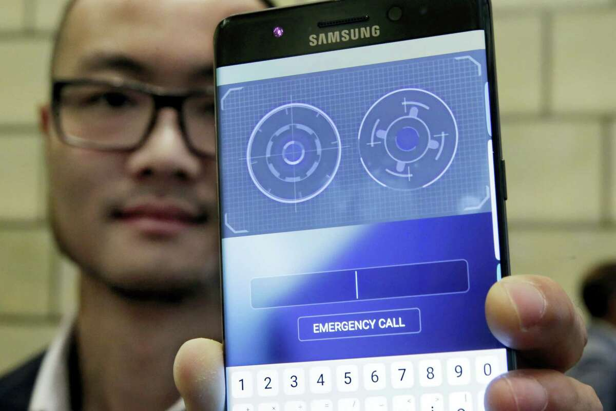 In this July 28, 2016 photo, Jonathan Wong of Samsung's Knox Product Marketing, shows the iris scanner feature of the Galaxy Note 7, in New York. Samsung releases an update to its jumbo smartphone and virtual-reality headset, mostly with enhancements rather than anything revolutionary during a preview of Samsung products.