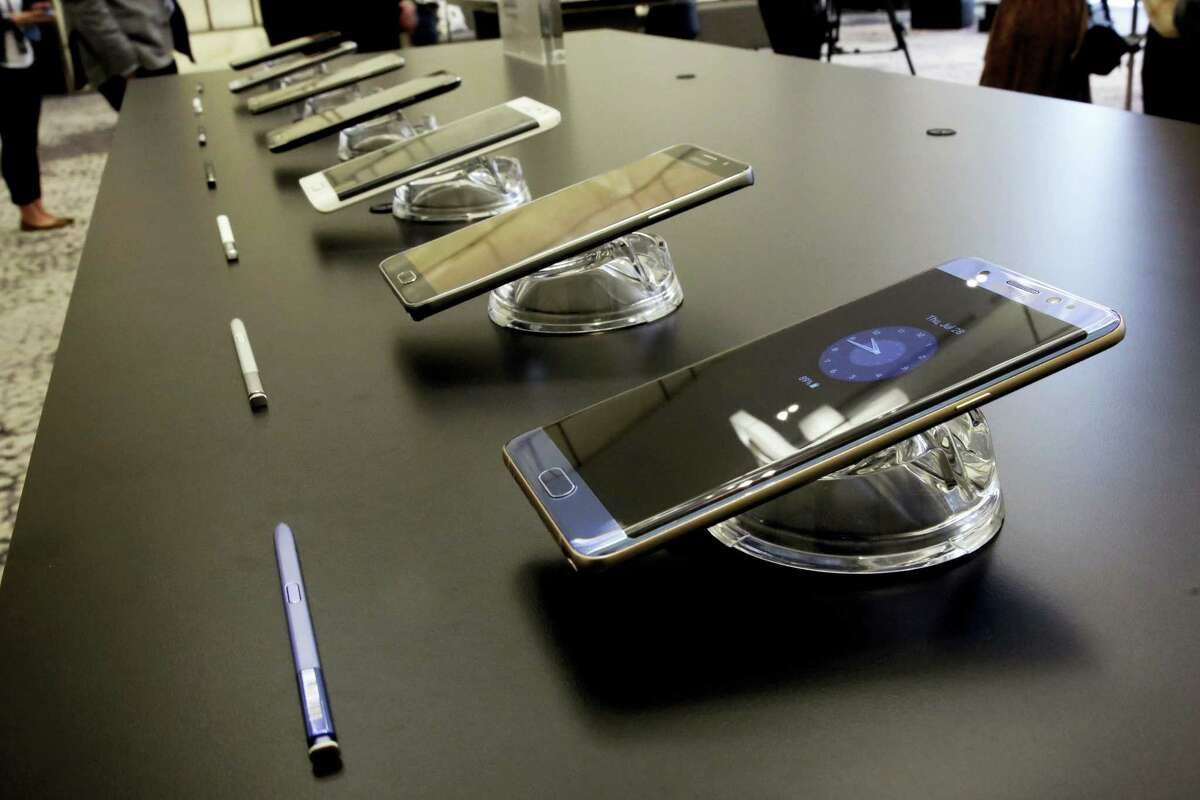 In this July 28, 2016 photo, the Galaxy Note 7, foreground, is displayed in New York.