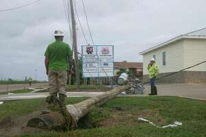North Houston Pole Line employees work on a fallen electric pole near the intersection of Bob Smith Road and Termini-San Luis Pass Road after Hurricane Harvey Saturday, Aug. 26, 2017, in Galveston.