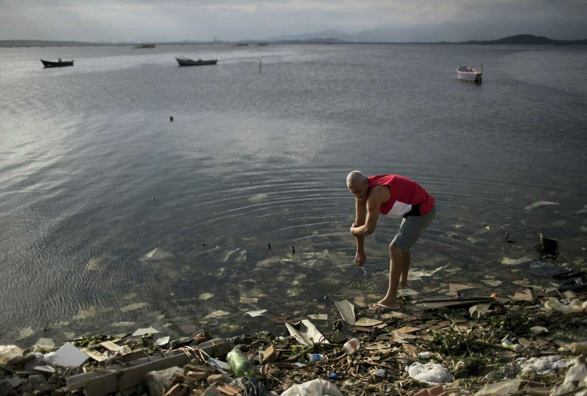 A man washes himself in the polluted waters of Guanabara Bay in Rio de Janeiro, Brazil on July 30, 2016.