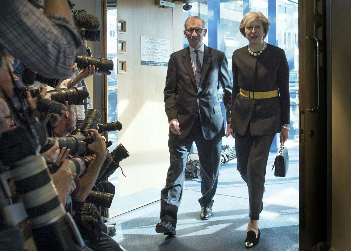 Britain's Prime Minister Theresa May and her husband Philip are watched by the media as they arrive at the Conservative Party Conference in Birmingham, England, Oct. 2.