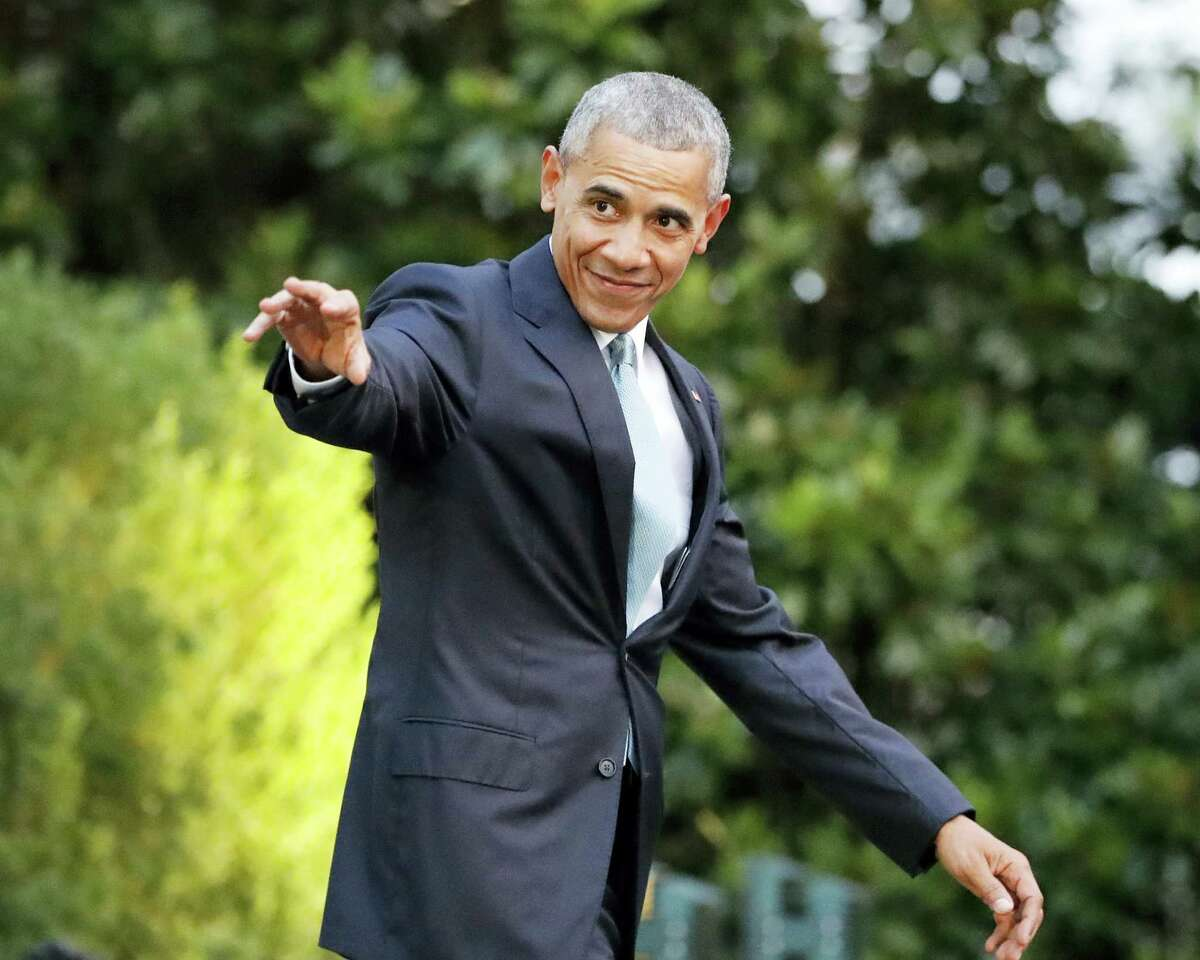 In this Wednesday, July 27, 2016 photo, President Barack Obama waves as he walks out to the South Lawn of the White House in Washington, before boarding Marine One helicopter for the short flight to nearby Andrews Air Force Base. Obama is touting strides in reducing homelessness among military veterans as his administration reaches the halfway point in building a massive database on veterans' health.