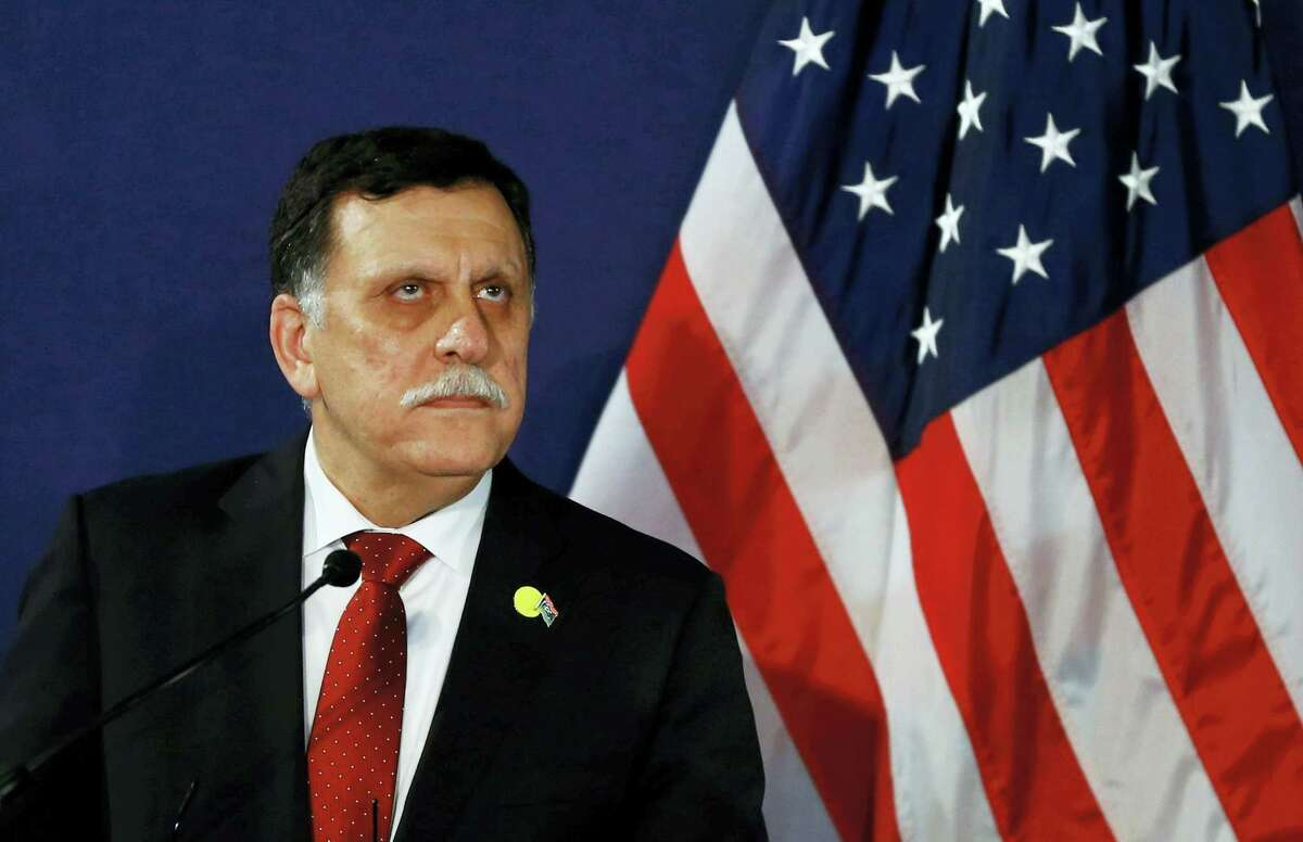 In this May 16, 2106 photo, Fayez al-Sarraj, the head of the U.N.-brokered presidency council, attends a news conference in Vienna, Austria. The U.S. launched multiple airstrikes against Islamic State militants Monday, Aug. 1, 2016, opening a new, more persistent front against the group at the request of the UN-backed Libyan government, Libyan and U.S. officials said.