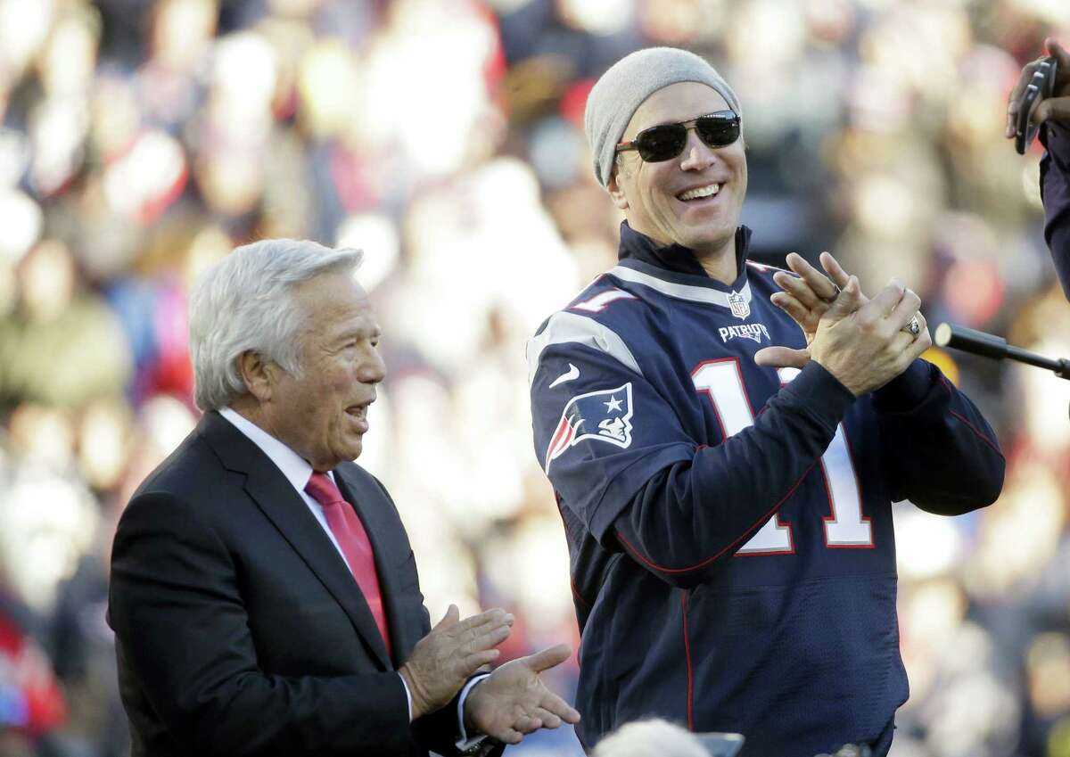 Member of the New England Patriots 2001 Super Bowl XXXVI team Drew Bledsoe, right, applauds while standing next to Patriots owner Robert Kraft as members of the 2001 Super Bowl XXXVI team were honored during halftime.