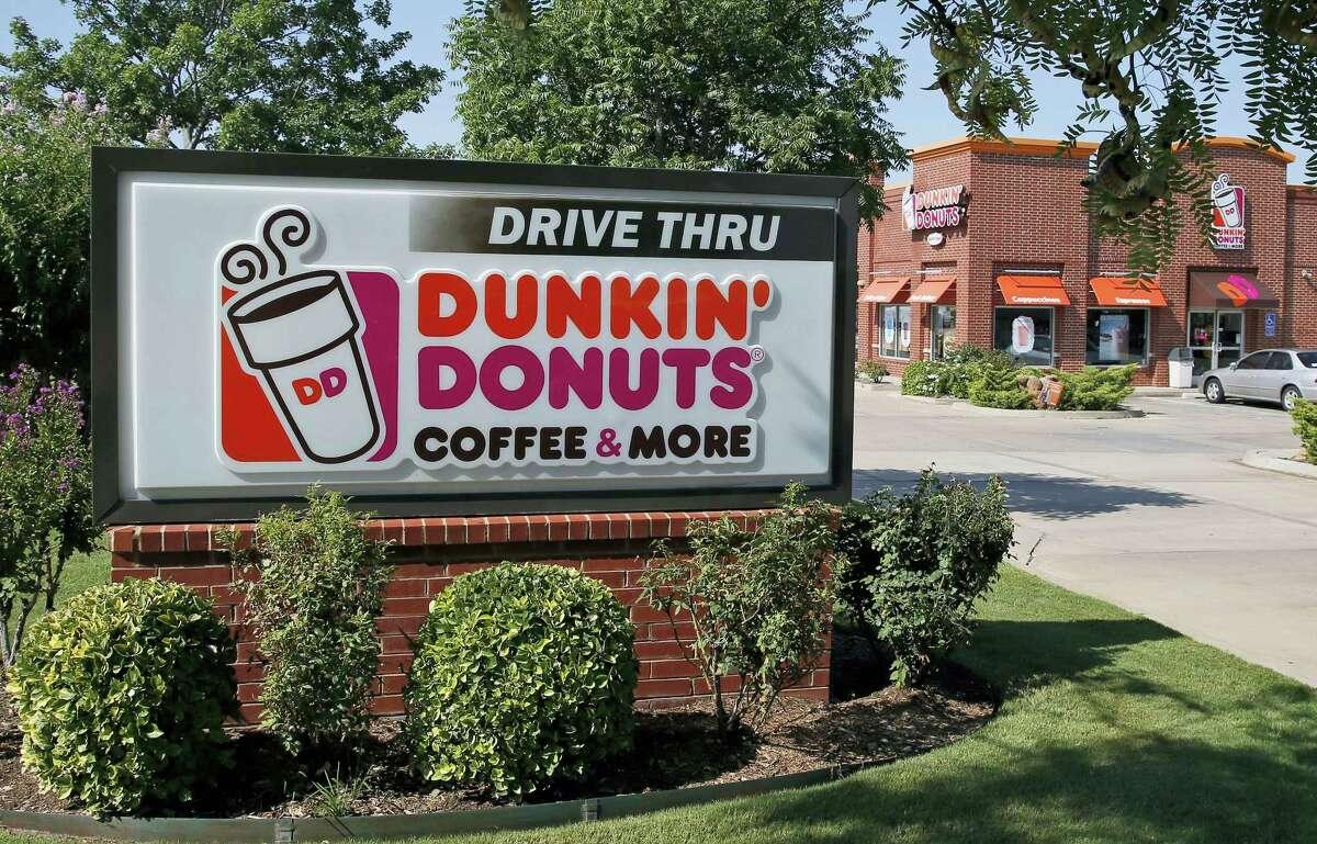 This Thursday photo shows a Dunkin' Donuts in Edmond, Okla. Already, the emergence of smaller rivals promising more wholesome alternatives has major restaurant chains scrambling to improve the image of their food. But some of the tweaks they're making underscore how far they have to go in changing perceptions. Dunkin' Donuts, for instance, says it plans to put more of a special ingredient in its egg patty: eggs.