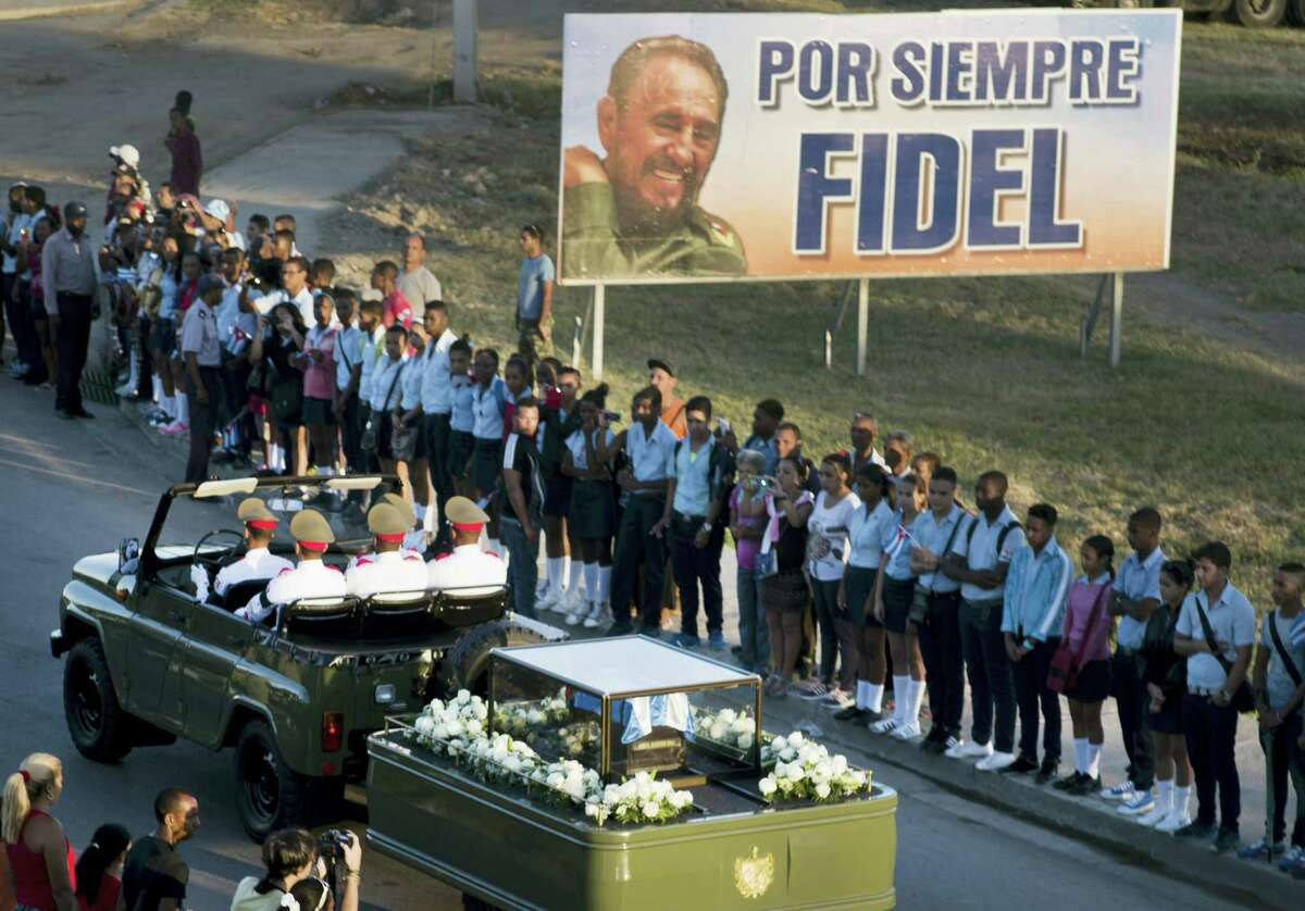 The motorcade carrying the ashes of the late Cuban leader Fidel Castro makes i's final journey towards the Santa Ifigenia cemetery in Santiago, Cuba Sunday, Dec. 4, 2016.