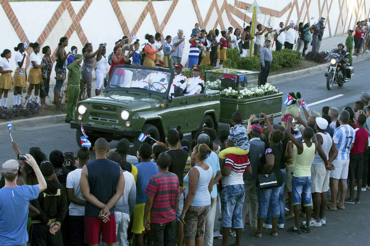 "The motorcade carrying the ashes of the late Cuban leader Fidel Castro makes i's final journey towards the Santa Ifigenia cemetery in Santiago, Cuba Sunday, Dec. 4, 2016. Thousands of people lined the short route from the Plaza Antonio Maceo or Plaza of the Revolution to the cemetery waving Cuban flags and shouting ""I am Fidel!""(AP Photo/Ricardo Mazalan)"