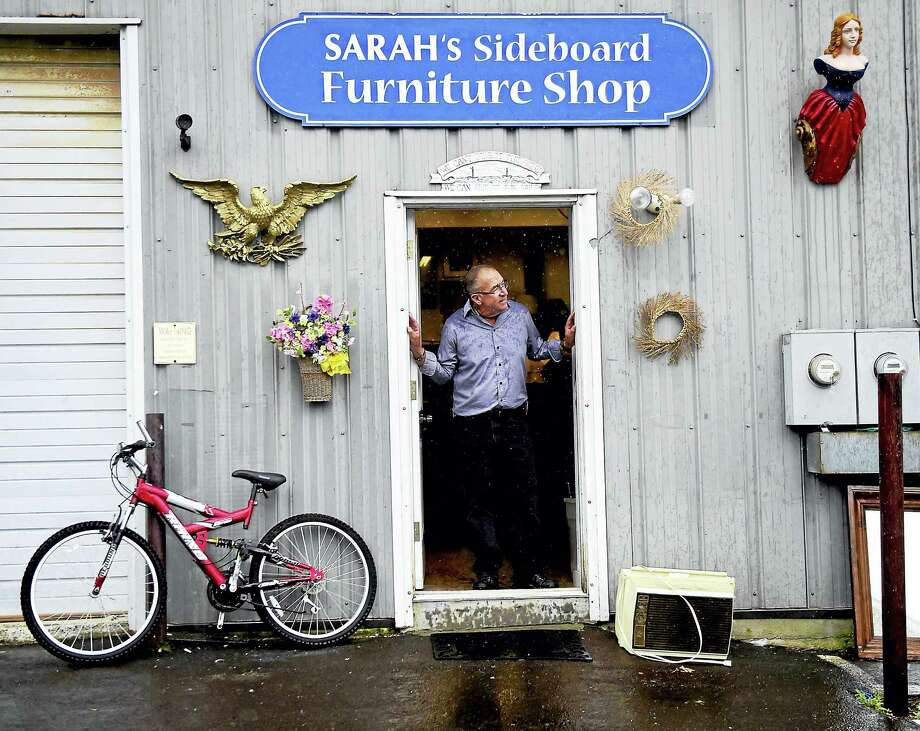 Branford,, Connecticut: Friday, August 18, 2017. Joe Vidal, store manager of SARAH's Cupboard Thrift Shop on Meadow Street in Branford in an annex of the thrift shop, SARAH's Sideboard Furniture Shop. Photo: Peter Hvizdak / Hearst Connecticut Media / New Haven Register