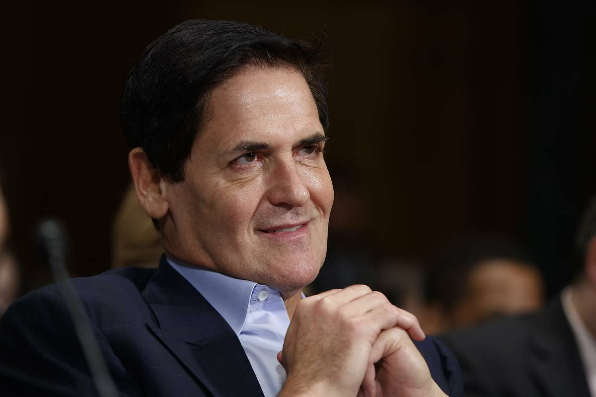 FILE - In this Dec. 7, 2016 file photo, AXS TV Chairman and Dallas Mavericks owner Mark Cuban listens on Capitol Hill in Washington. Just seven months into the Trump presidency, Republicans and right-leaning independents have begun to contemplate the possibility of an organized bid to take down a sitting president from within. (AP Photo/Evan Vucci, File)