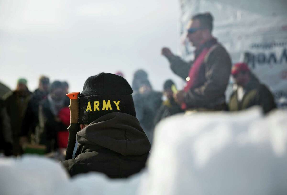 An Army veteran attends a briefing for fellow veterans at the Oceti Sakowin camp where people have gathered to protest the Dakota Access oil pipeline in Cannon Ball, N.D. on Dec. 3, 2016.