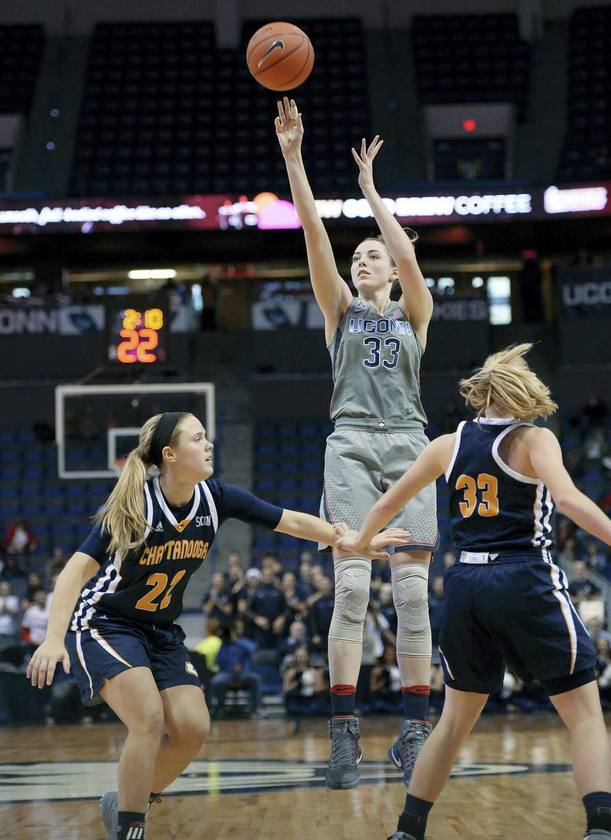 UConn's Katie Lou Samuelson shoots over Chattanooga's Shelbie Davenport, left, and Lakelyn Bouldin during a game earlier this season.