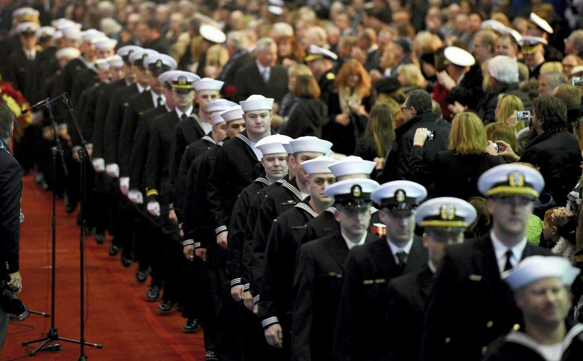 The crew of the USS Colorado arrives for its christening ceremony in Groton, Conn., on Saturday, Dec. 3, 2016. The 377-foot-long vessel is the 15th in the Virginia class of attack submarines, each costing $2.7 billion.
