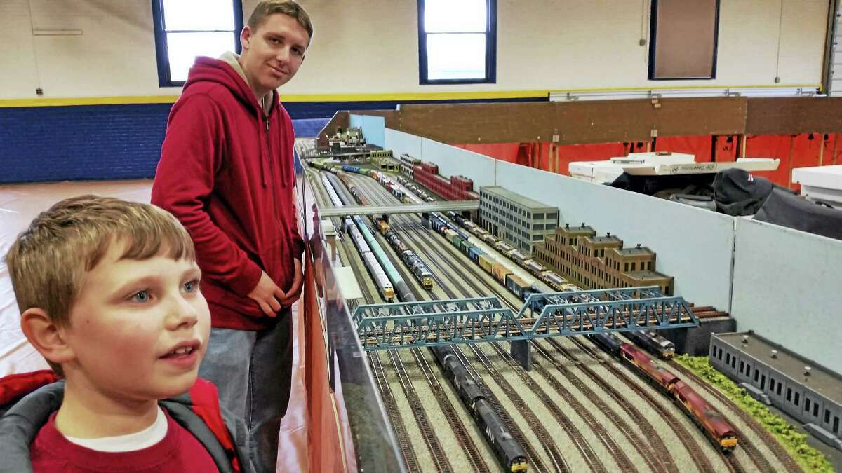 Participants enjoy the 16th annual Holiday Model Train Show & Canned-Food Drive at the Torrington Armory Saturday afternoon.
