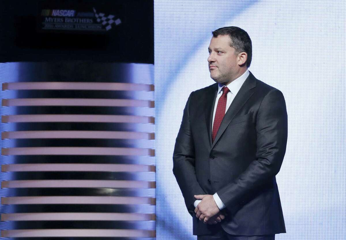 Tony Stewart stands on stage during the NASCAR NMPA Myers Brothers Awards Luncheon, Thursday in Las Vegas.