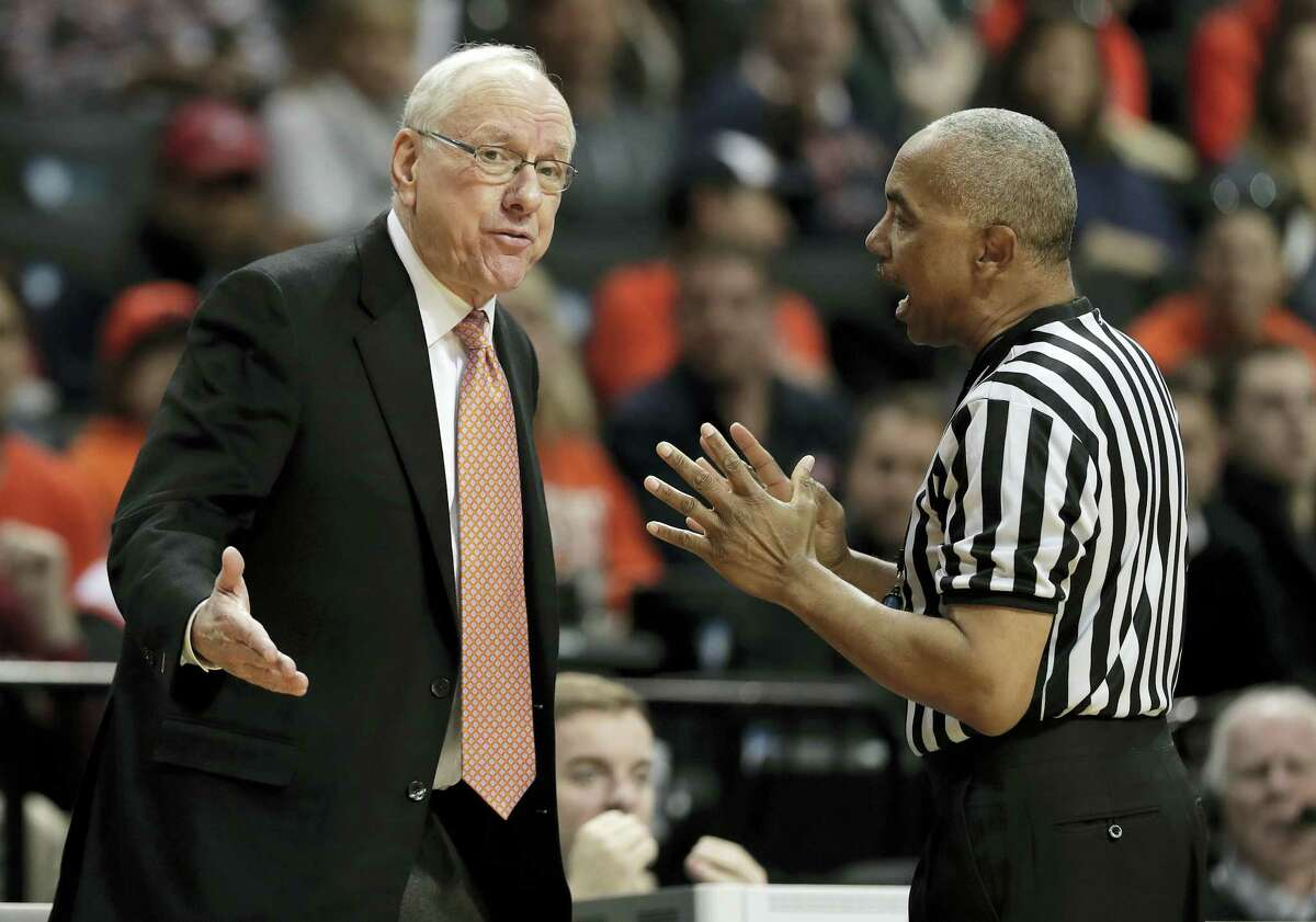 Syracuse head coach Jim Boeheim, left, talks with a referee during a recent game.