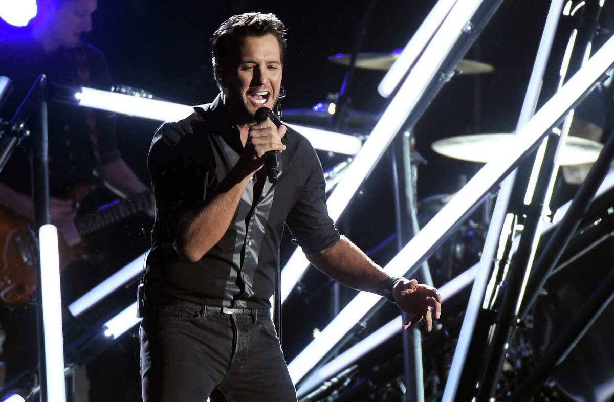 """In this Nov. 2, 2016, file photo, Luke Bryan performs """"Move"""" at the 50th annual CMA Awards at the Bridgestone Arena in Nashville, Tenn. Video shows Bryan slapping a heckler with his fingers while still holding the microphone during a show in Nashville on Nov. 30, 2016. Bryan then continued with the song seeming unfazed by the incident."""