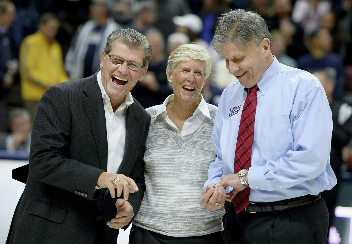 UConn head coach Geno Auriemma, left, and DePaul head coach Doug Bruno, right, react after receiving their Olympic rings from USA Basketball Women's National Team Director Carol Callan during a pregame ceremony before a game between the two teams Thursday.