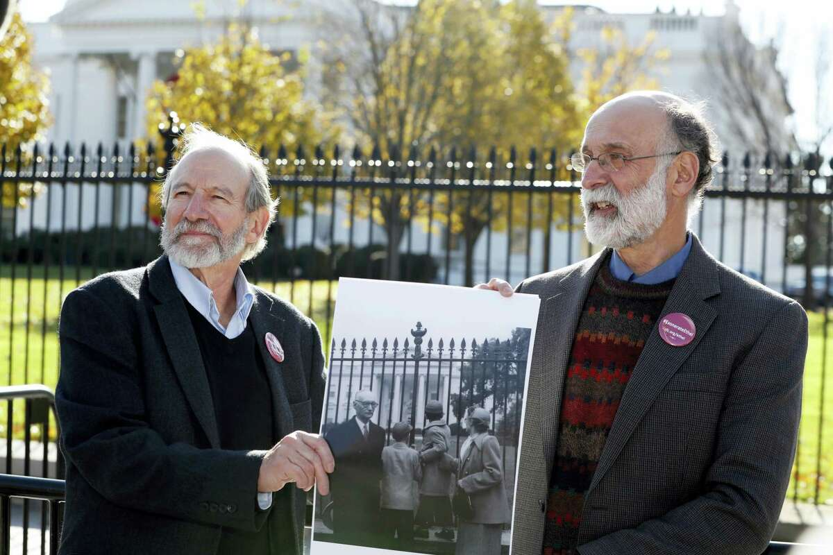 Michael, left, and Robert Meeropol, the sons of Ethel Rosenberg, pose similar to an old photograph of them, before they attempt to deliver a letter to President Barack Obama in an effort to obtain a pardon for their mother Ethel Rosenberg, in front of the White House, Thursday, Dec. 1, 2016 in Washington. Ethel Rosenberg was executed, along with her husband, Julius, in 1953 after being convicted in a Cold War atomic spying case that captivated the country.