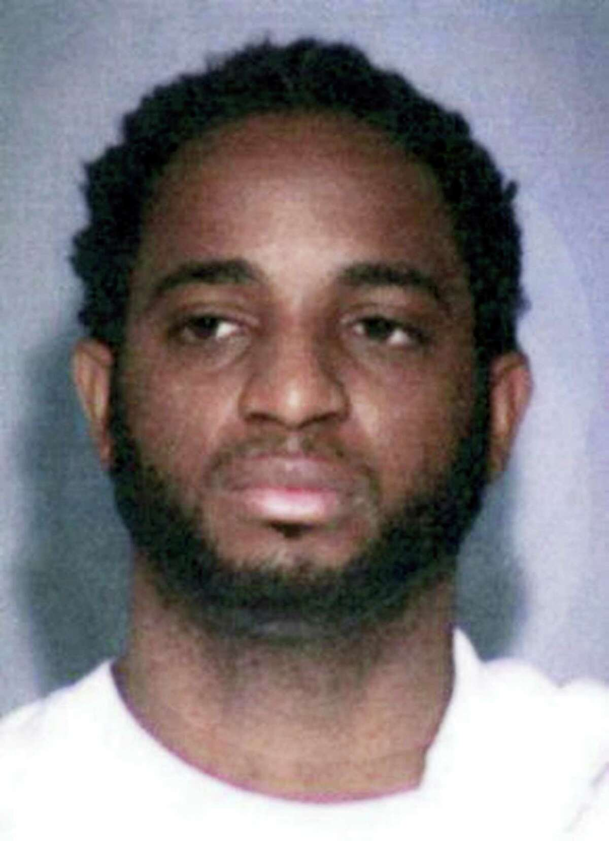 """This undated photo provided by the FBI shows fugitive Marlon Jones who is wanted for multiple counts of murder in Los Angeles. The FBI has added Jones, a Jamaican fugitive to its most-wanted list as a suspect in the slaying of four people at a Los Angeles birthday party in October. The FBI announced a reward on Thursday, Dec. 1, 2016 of up to $100,000 for information leading to the arrest of Jones who should be """"considered armed and extremely dangerous."""""""
