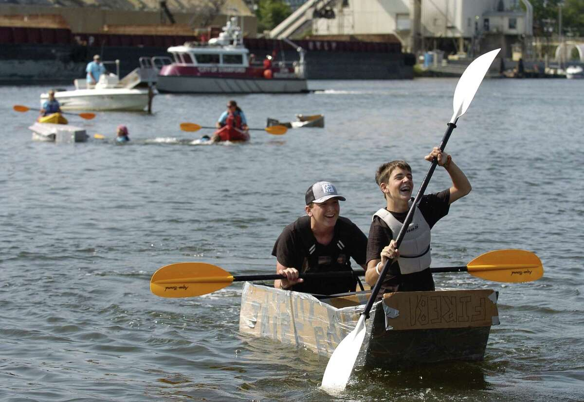 Griffen Gigliotti and friend Max Touzot, both of Stamford, celebrate winning the Soundwaters Harborfest 17 Cardboard Kayak Race for team Tribe Boys in Stamford, Connecticut on Saturday, August 25, 2017.