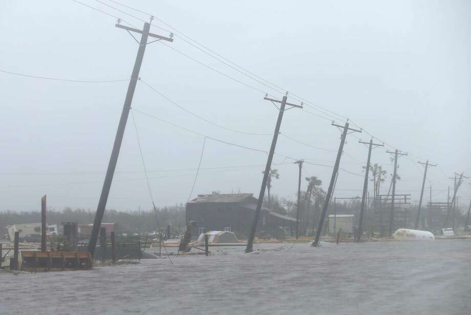In Rockport, Harvey left long rows of leaning power poles. Photo: Godofredo A. Vasquez, Houston Chronicle / Godofredo A. Vasquez