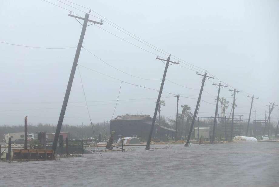 In Rockport, Harvey left long rows of leaning power poles. Photo: Godofredo A. Vasquez, Houston Chronicle / Godofredo A. Vasquez