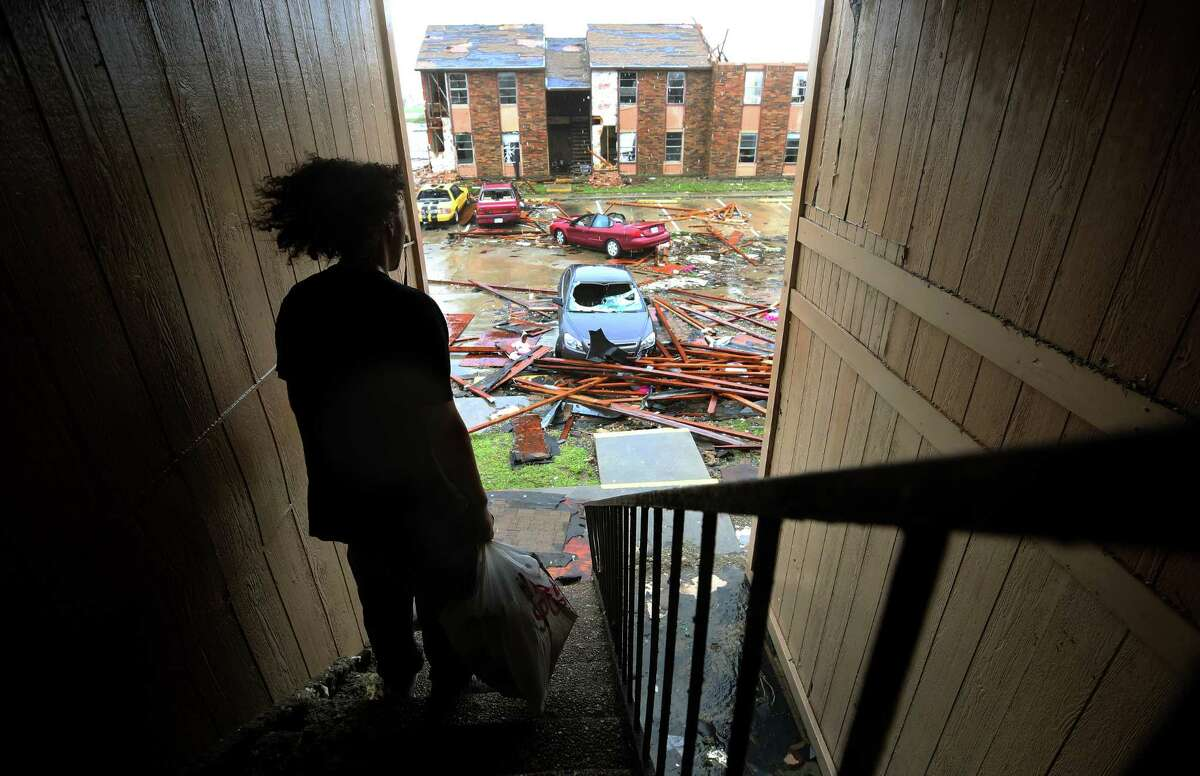Nathan Kaufman stands on the stairwell of the apartment complex he lived in before Hurricane Harvey Saturday, Aug. 26, 2017, in Rockport, Texas.