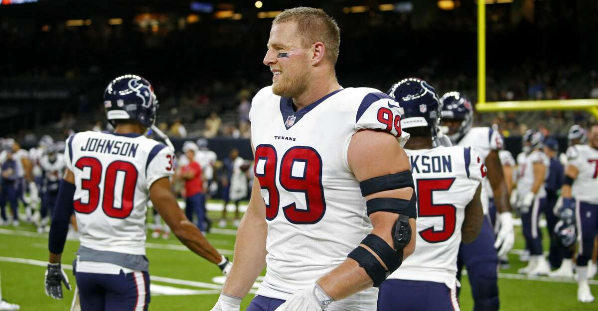Houston Texans defensive end J.J. Watt (99) warms up before a preseason NFL football game against the New Orleans Saints in New Orleans, Saturday, Aug. 26, 2017. (AP Photo/Butch Dill)