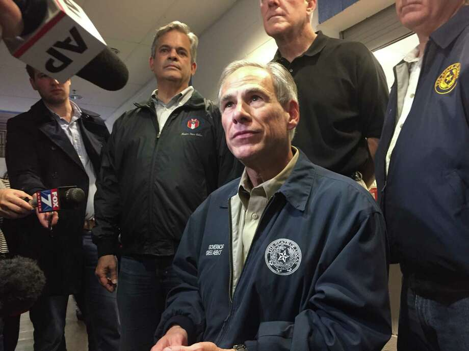 Gov. Greg Abbott hears from state emergency management officials in Austin about Hurricane Harvey. Photo: Andrea Zelinski