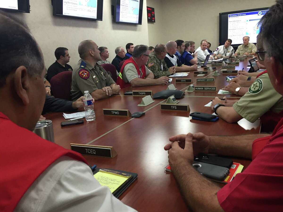 Gov. Greg Abbott hears from state operations personnel in Austin about the latest weather predictions and flooding concerns early afternoon Saturday, Aug. 26, 2017, before Hurricane Harvey was downgraded from a Category 1 Hurricane to a tropical storm.