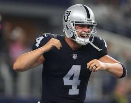 ARLINGTON, TX - AUGUST 26: Derek Carr #4 of the Oakland Raiders reacts after a second quarter touchdown against the Dallas Cowboys in a preseason game at AT&T Stadium on August 26, 2017 in Arlington, Texas. (Photo by Tom Pennington/Getty Images)