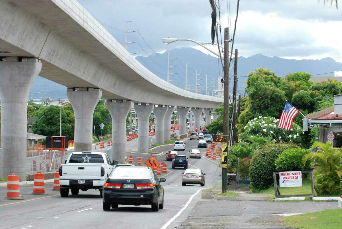 In this May 18, 2017 photo, a rail line under construction winds through the Honolulu suburb of Aiea, Hawaii. Honolulu's planned $9.5 billion rail transit project is one of the most expensive per capita in the nation. But it's facing a multi-billion dollar budget shortfall, and the future of the project is in jeopardy. Hawaii lawmakers are meeting this week to decide how to cover a budget shortfall as high as $3 billion. (AP Photo/Cathy Bussewitz) ORG XMIT: FX402