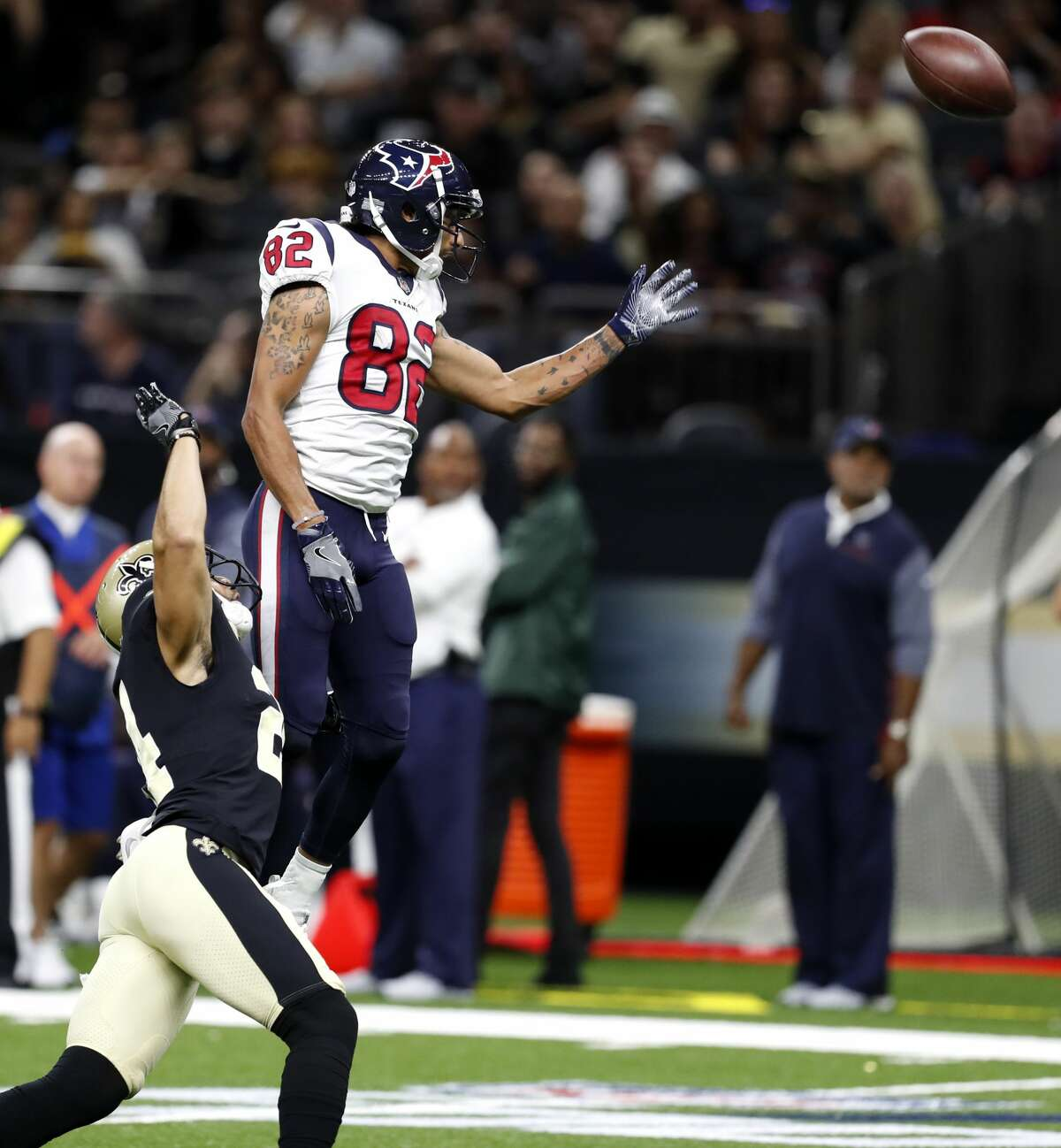 Houston Texans wide receiver Wendall Williams (82) can't come down with a pass over his head with New Orleans Saints cornerback Sterling Moore (24) defending during the third quarter of an NFL pre-season football game at the Mercedes-Benz Superdome on Saturday, Aug. 26, 2017, in New Orleans. ( Brett Coomer / Houston Chronicle )