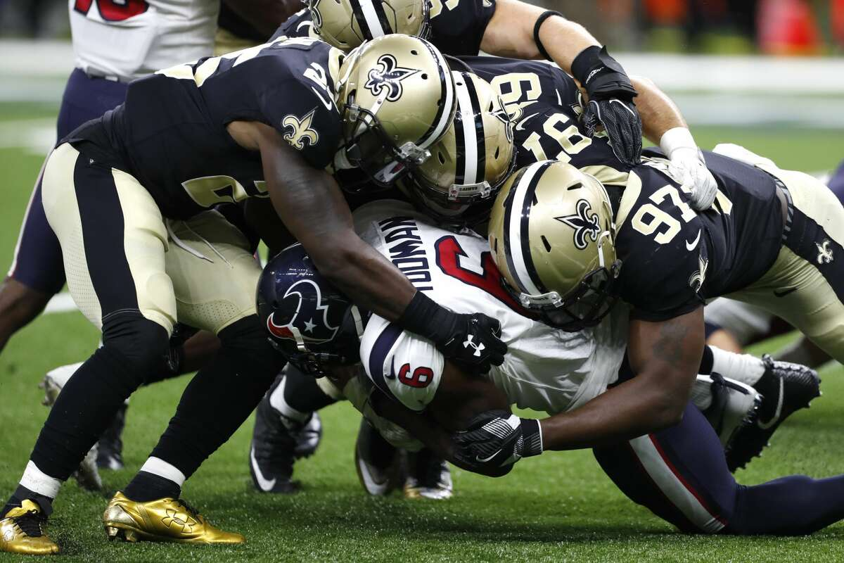 Houston Texans running back Jordan Todman (6) is stopped by New Orleans Saints defensive end Al-Quadin Muhammad (97) during the third quarter of an NFL pre-season football game at the Mercedes-Benz Superdome on Saturday, Aug. 26, 2017, in New Orleans. ( Brett Coomer / Houston Chronicle )