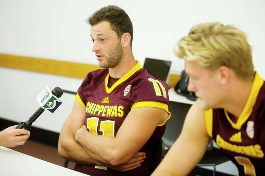 Central Michigan University quarterbacks Shane Morris, left, and Tony Poljan, right, answer questions during a press conference on Sunday at the Central Michigan University Student Activity Center in Mt. Pleasant. (Katy Kildee/kkildee@mdn.net)