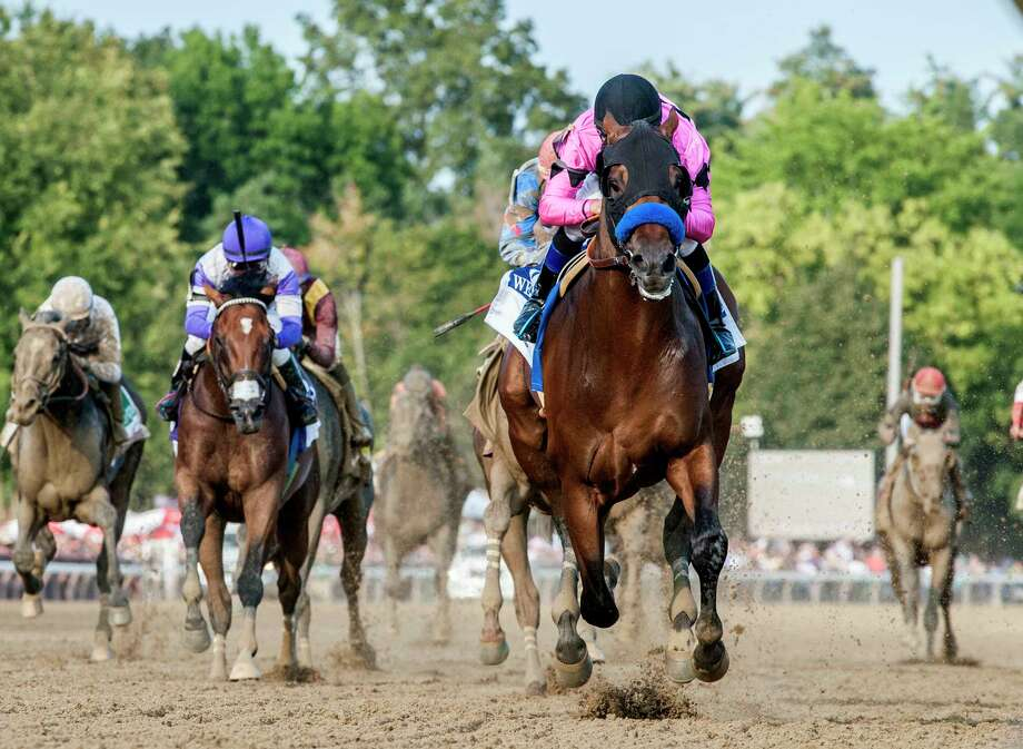 Jockey Mike Smith wins the 148th running of the Travers Stakes with West Coast at the Saratoga Race Course in Saratoga Springs, N.Y.  (Skip Dickstein/Times Union) Photo: SKIP DICKSTEIN