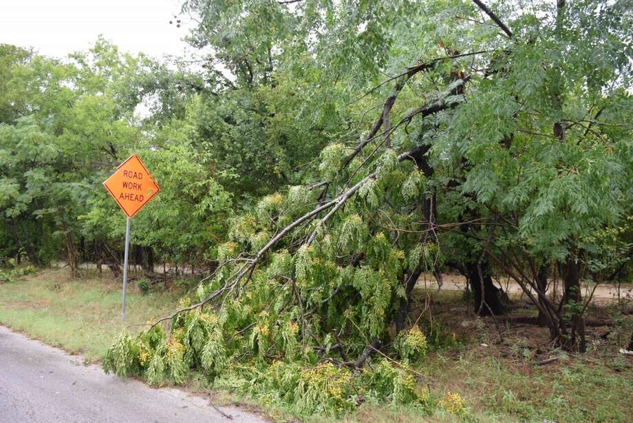 Several trees on Ira Lee Road on the Northeast Side were downed when Tropical Storm Harvey passed through San Antonio. Much of the wreckage had been cleared from the road by Sunday Aug. 27, 2017. Photo: Caleb Downs