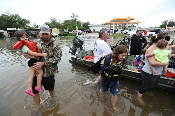 Neighbors with boats are using their personal boats to rescue Friendswood residents near FM 2351 and FM 518.