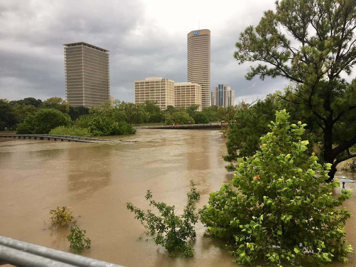 The Buffalo Bayou swelled over its banks, swallowing portions of Memorial Drive and the pedestrian bridges that cross it after Hurricane Harvey, Sunday, Aug. 27, 2017. Maggie Gordon/Houston Chronicle