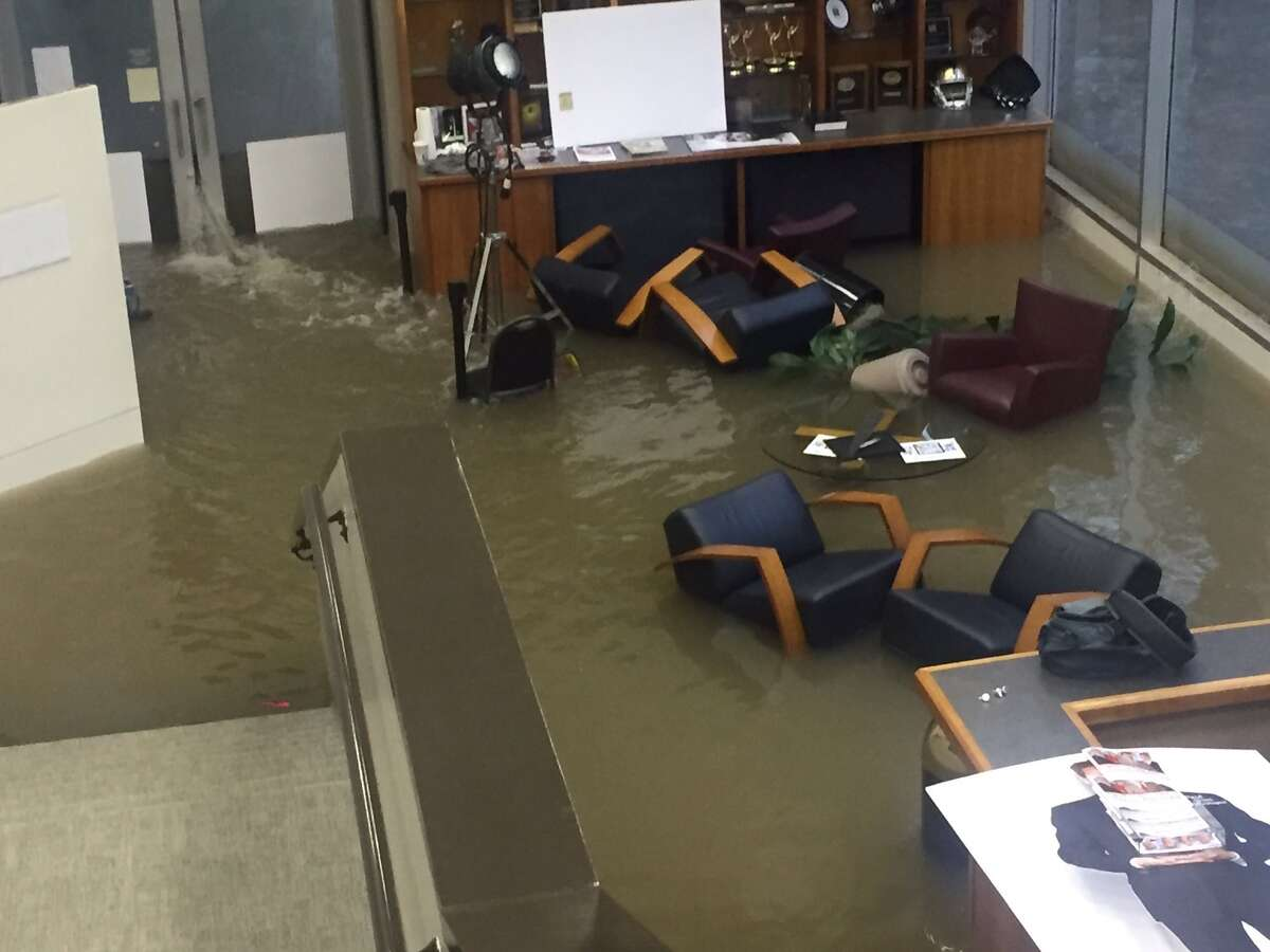 Office chairs sit in flood waters inside the KHOU offices during Hurricane Harvey, Sunday, Aug. 27, 2017.