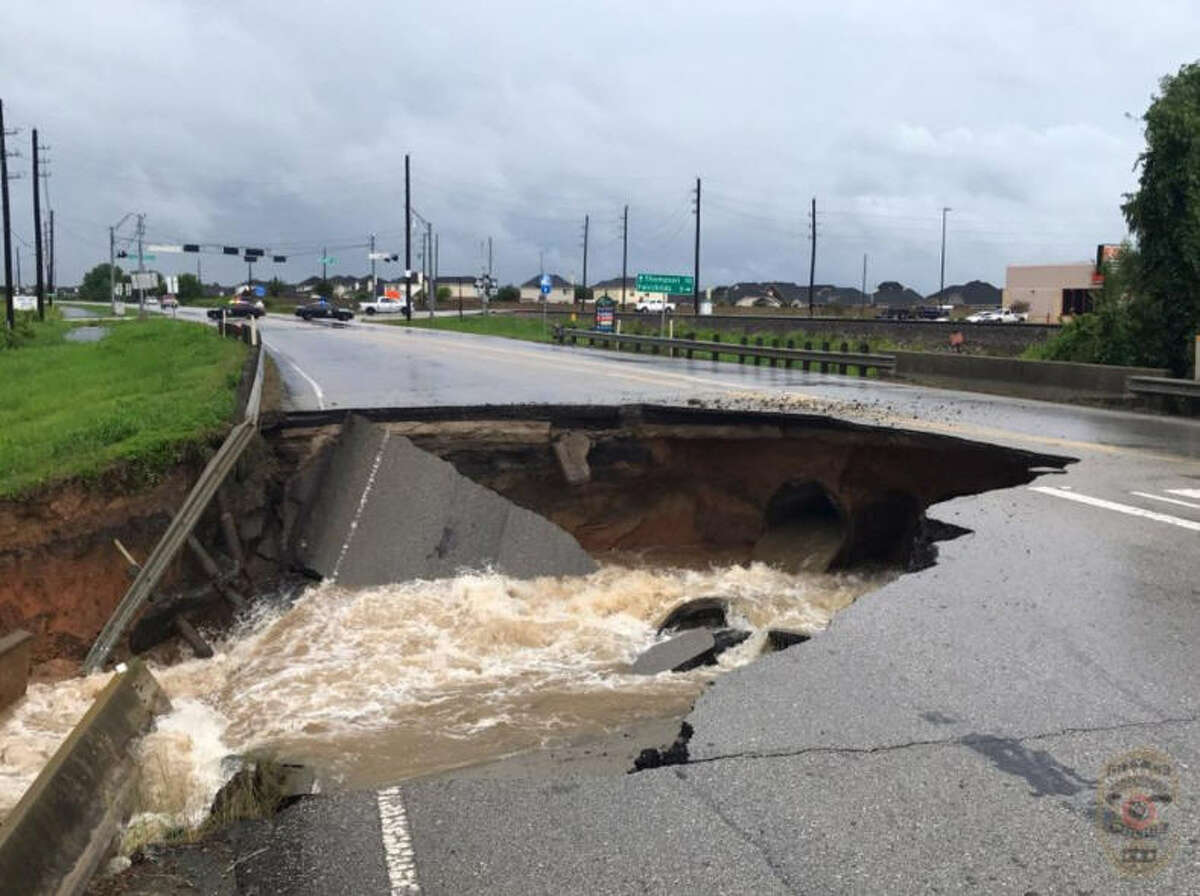 Photos: Tropical Storm Harvey drenches Texas The Rosenberg Police Department posted this photo of a massive sinkhole that swallowed portion of FM 762 on Sunday, Aug. 27, 2017. See more images of the impacts of Tropical Storm Harvey on the Houston area.