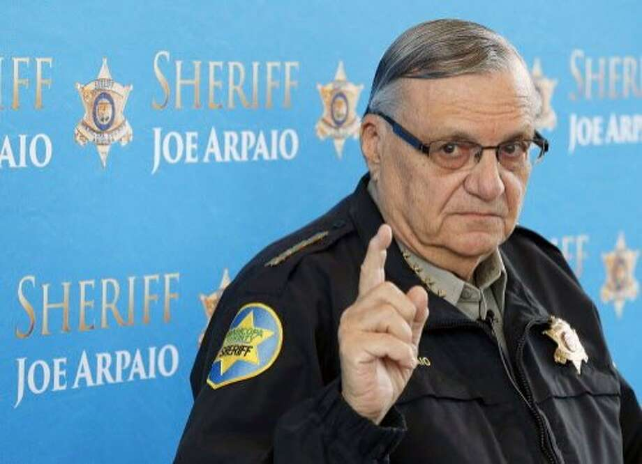 "FILE - In this Dec. 18, 2013, file photo, Maricopa County Sheriff Joe Arpaio speaks at a news conference at the Sheriff's headquarters in Phoenix, Ariz. President Donald Trump has pardoned former sheriff Joe Arpaio following his conviction for intentionally disobeying a judge's order in an immigration case. The White House announced the move Friday night, Aug. 25, 2017, saying the 85-year-old ex-sheriff of Arizona's Maricopa County was a ""worthy candidate"" for a presidential pardon. (AP Photo/Ross D. Franklin, File) Photo: Ross D. Franklin, Associated Press"
