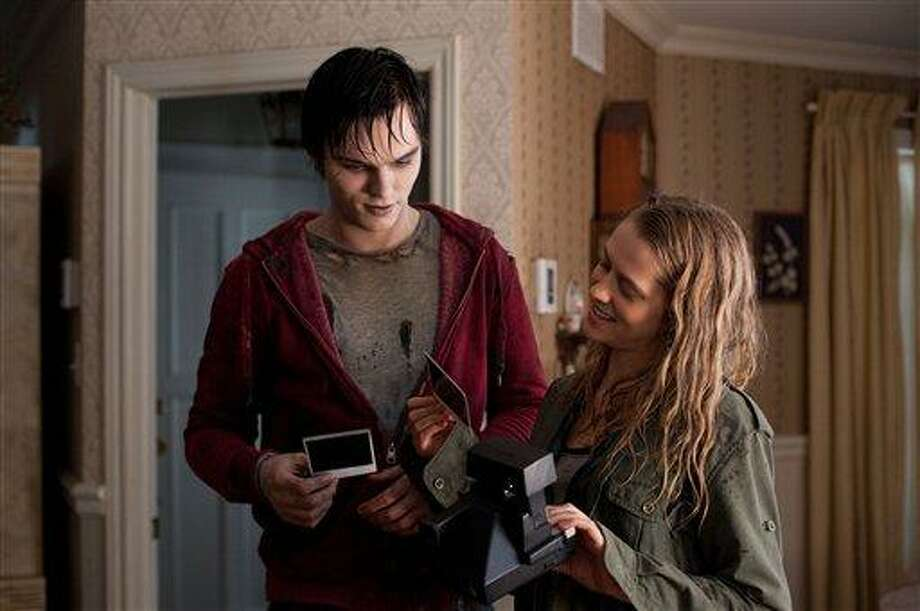 "This film image released by Summit Entertainment shows Nicholas Hoult, left, and Teresa Palmer in a scene from ""Warm Bodies."" (AP Photo/Summit Entertainment, Jonathan Wenk) Photo: AP / Summit Entertainment"