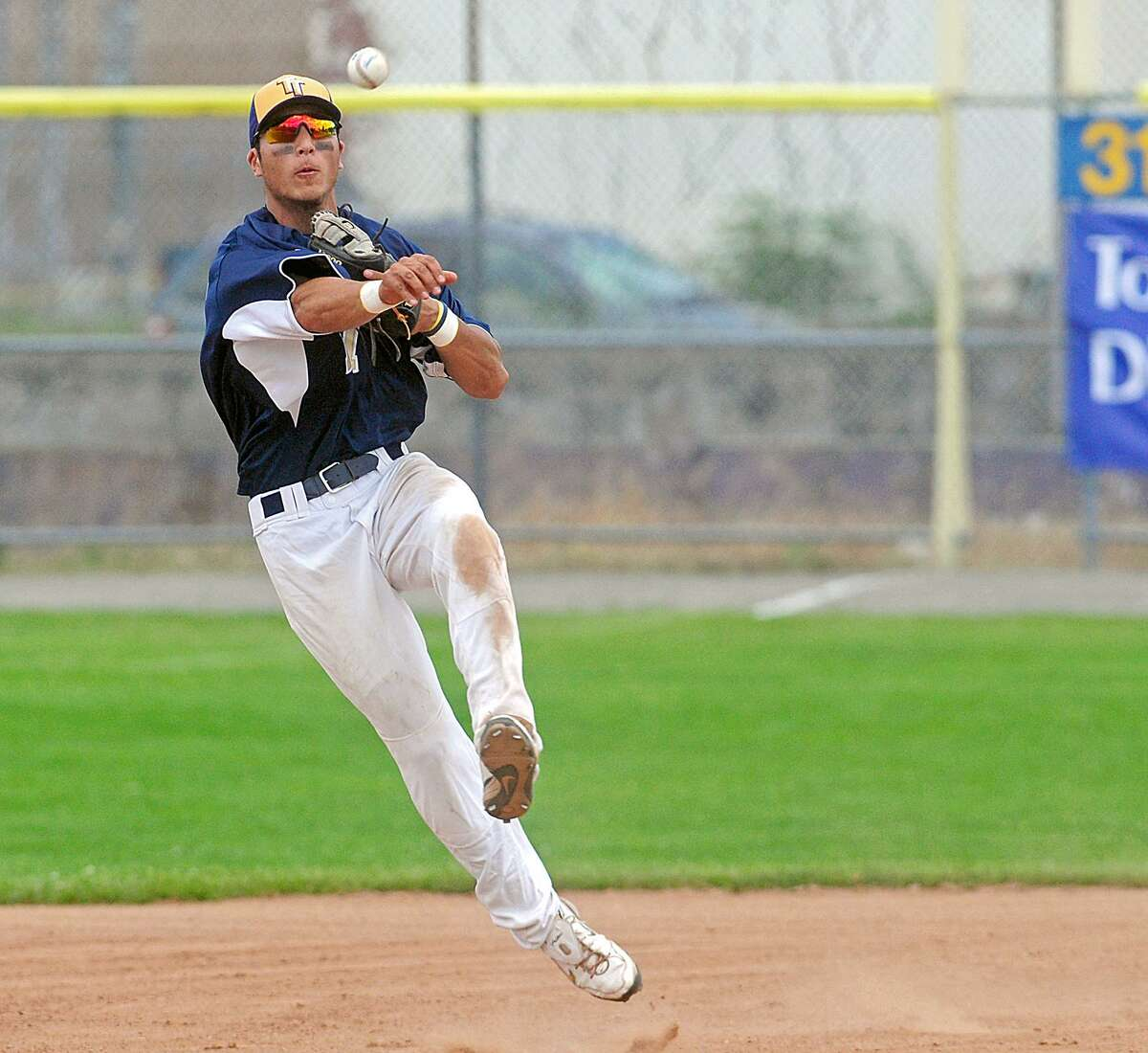 A Torrington Titans player makes a running play to save a basehit. File Photo/Register Citizen