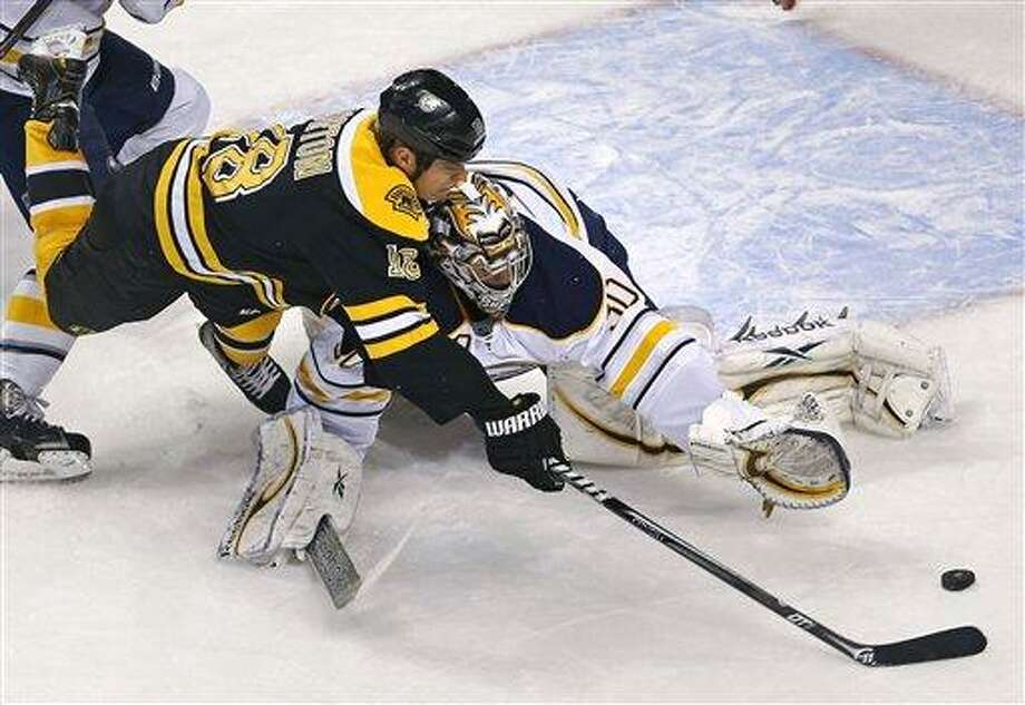 Boston Bruins right wing Nathan Horton (18) stretches to make the shot as Buffalo Sabres goalie Ryan Miller (30) makes a save during the first period of an NHL hockey game in Boston, Thursday, Jan. 31, 2013. (AP Photo/Charles Krupa) Photo: ASSOCIATED PRESS / AP2013