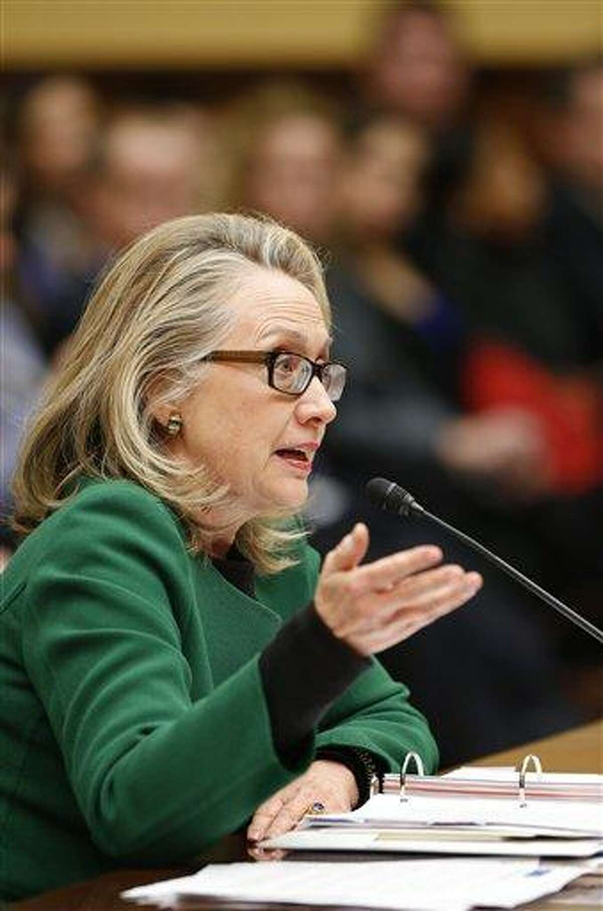 Secretary of State Hillary Rodham Clinton testifies on Capitol Hill in Washington, Wednesday, Jan. 23, 2013, before the House Foreign Affairs Committee hearing on the deadly September attack on the U.S. diplomatic mission in Benghazi, Libya, that killed Ambassador Chris Stevens and three other Americans. (AP Photo/J. Scott Applewhite)